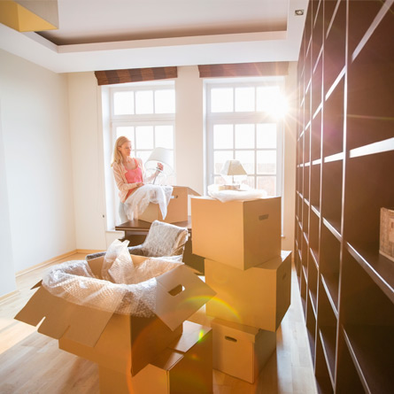 woman packing boxes to move