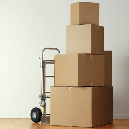 moving boxes on a hand cart