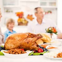 family enjoying thanksgiving without pests