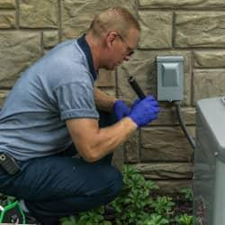 moyer technician inspecting outside of a home