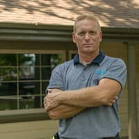 technician protecting a home from pests