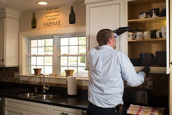 moyer technician inspecting a kitchen for pests in fogelsville pennsylvania