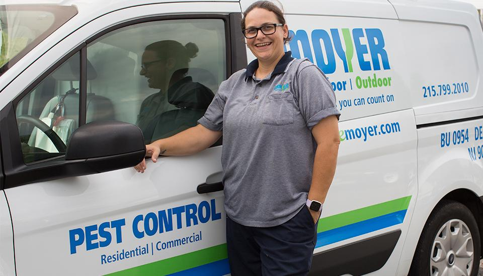 moyer commercial pest control tech in front of business in allentown
