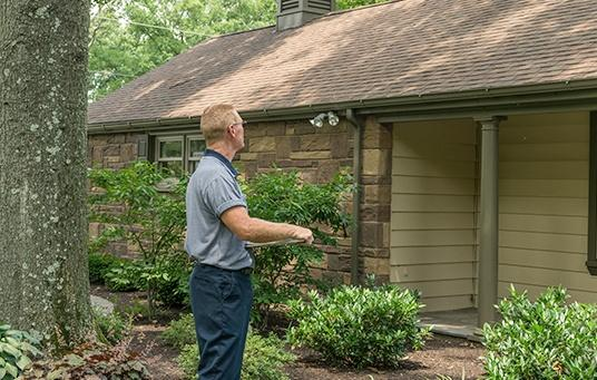 moyer professional in front of a home