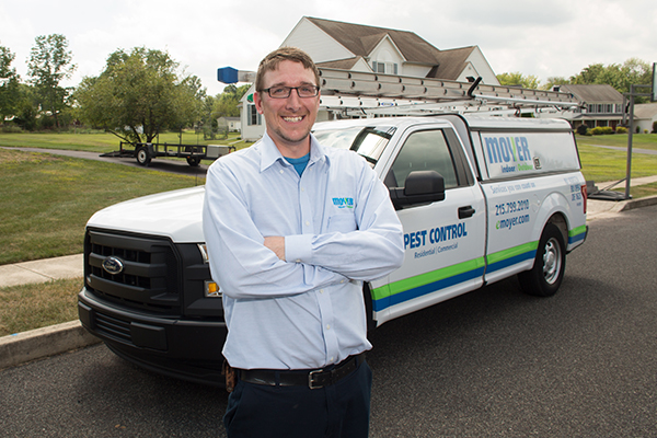 branded pest control vehicle and moyer pest control professional in levittown pa
