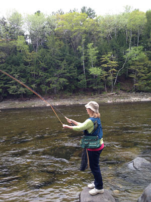 owner rebecca webster taking a break from chaga hunting to fly fish in maine