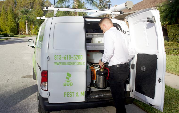 technician getting product from van