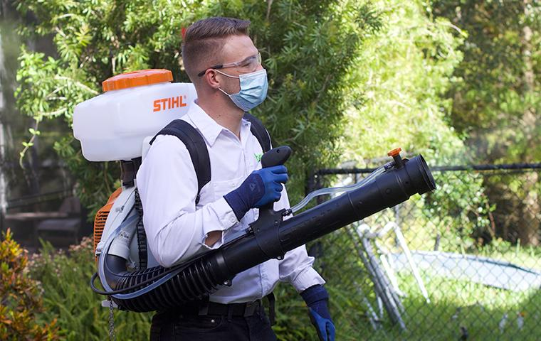 technician treating for mosquitoes