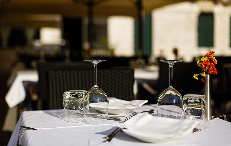 a dinner table setting inside of a restaurant in austin texas