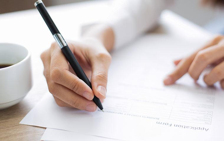a person filling out an application