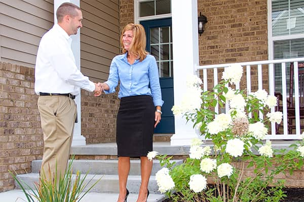 a service technician shaking hands with a homeowner outide a salem virginia home