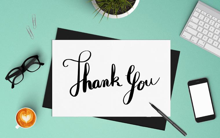 a thank you note on a desk