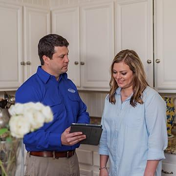 a jury pest services technician with a homeowner in north augusta south carolina