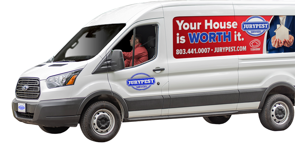a jury pest services company vehicle in front of a home in north augusta south carolina