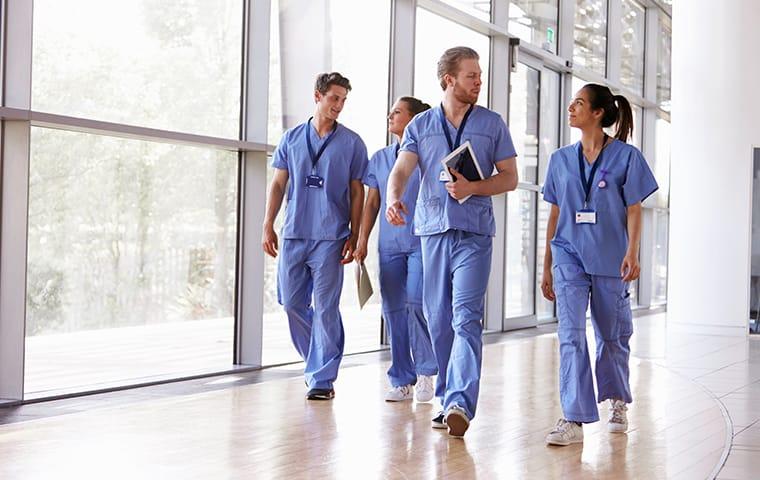 four staff members walking in a hospital hallway in columbia south carolina