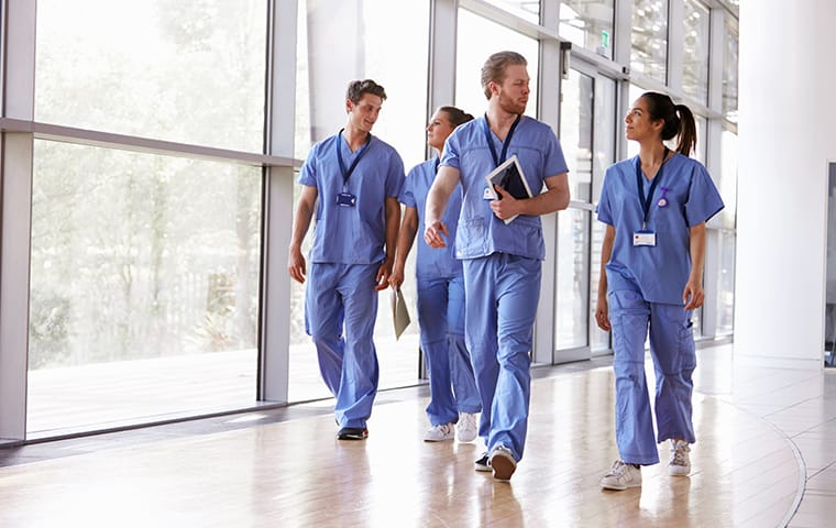 four staff members walking in a hospital hallway in columbia south carolina