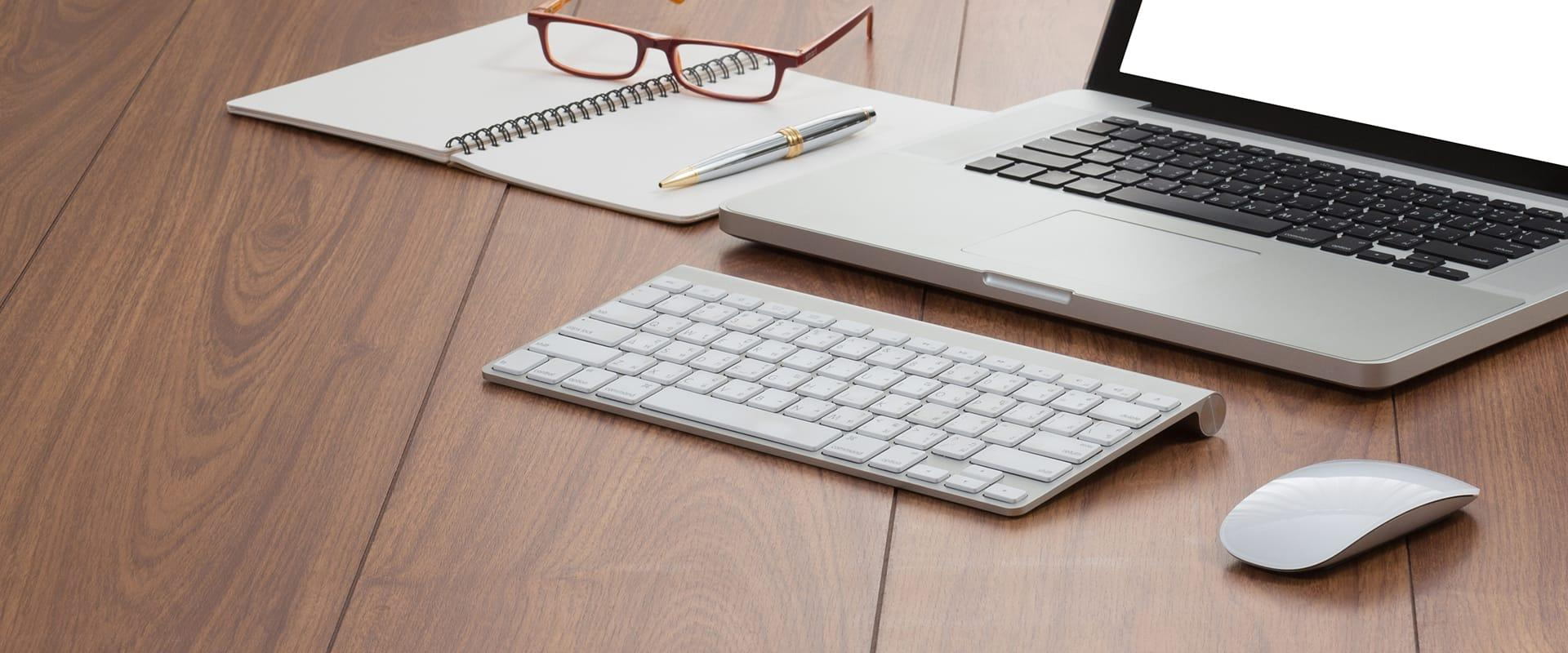 laptop with keyboard on desk