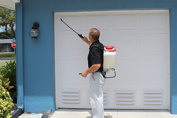 technician treating the exterior of a home in florida