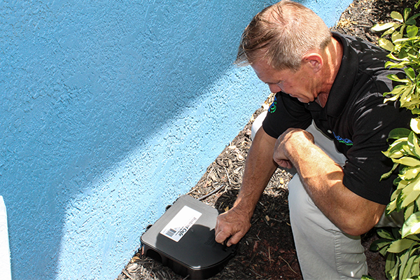 technician placing a rodent trap at a florida home