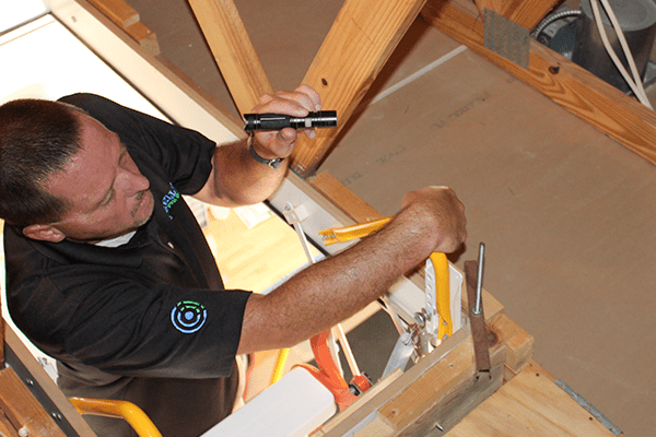technician inspecting an the attic of a florida home