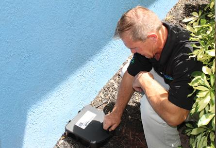 a pest technician checking a rodent trap