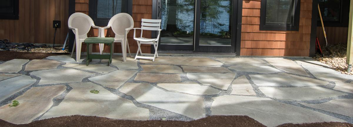 Stone patio with chairs