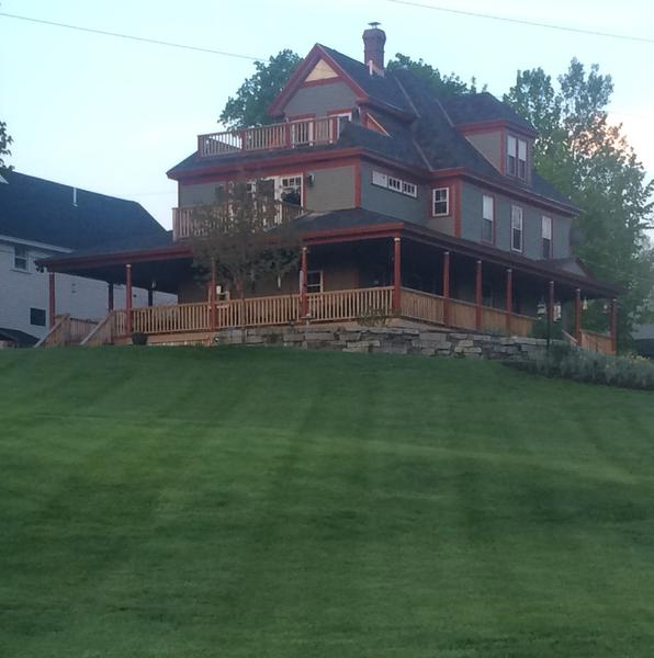 Large mowed lawn on a hill