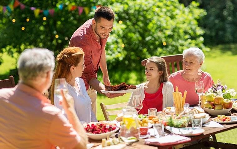 a family eating outside