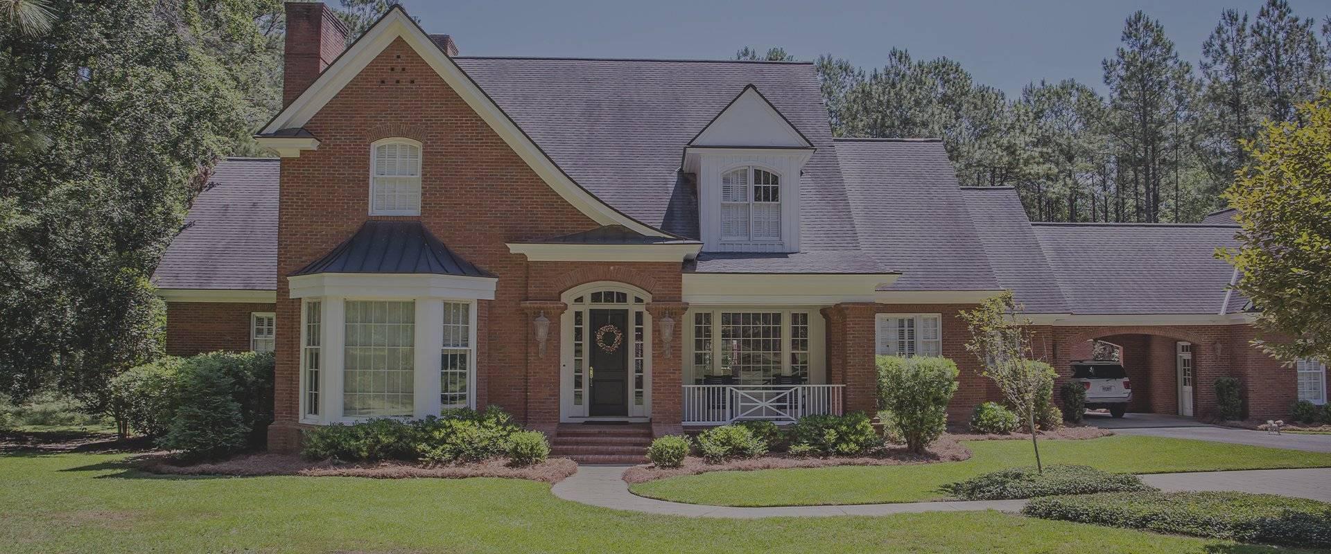 nice home with paved driveway