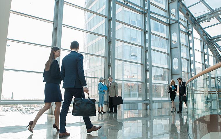 people walking in an office building