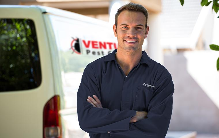 technician standing in front of a company van