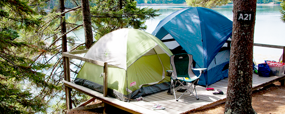 two tents on platform overlooking the water