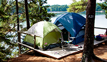two tents on a platform overlooking the water