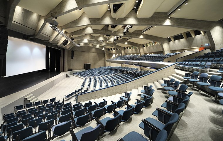 a large open convention center with many empty chairs