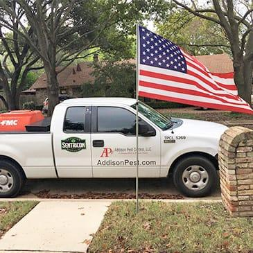 a company vehicle parked outside a home in dallas texas