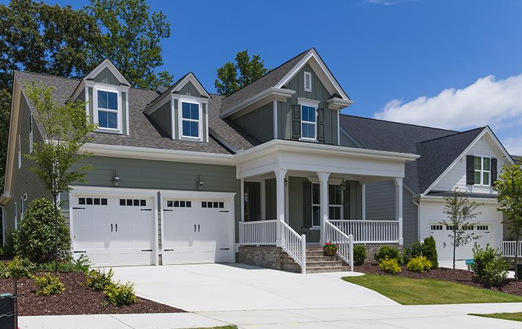sidewalk view of a gray house in hendersonville north carolina
