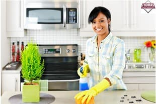 ny resident cleaning a kitchen