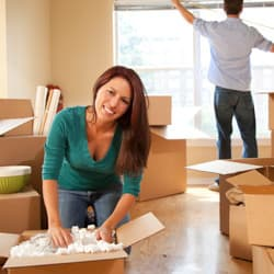 woman unpacking from move
