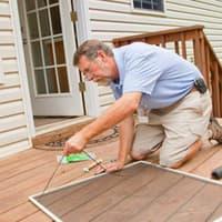Homeowner repairing screen