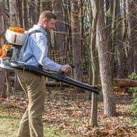 mosquito control technician treating backyard