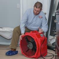 Thomas pest control technician setting up bed bug heat treatment