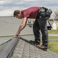 thomas technician fixing a problem on roof