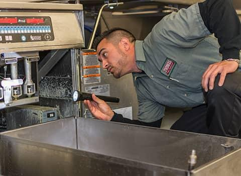 technician inspecting ballston lake commercial facility