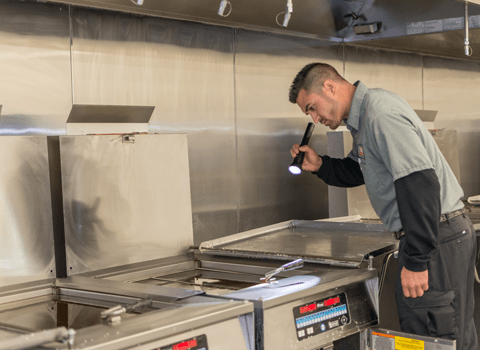 technician inspecting commercial kitchen in valaite ny