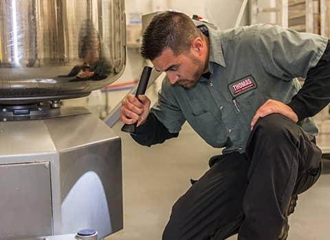 technician inspecting halfmoon commercial facility