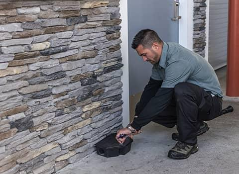 technician checking rodent station in wilton