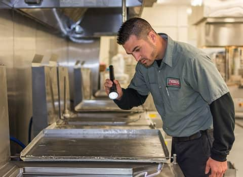 technician inspecting ballston commercial kitchen