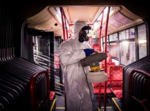 a technician treating a subway car for coronavirus