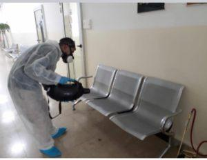 a technician treating a waiting room for coronavirus