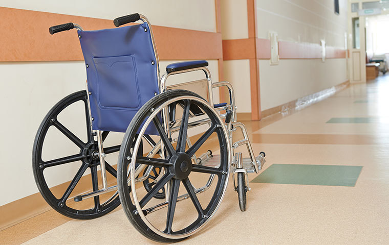 a wheel chair in the hall way of a hospital